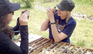 Two students inspecting core samples